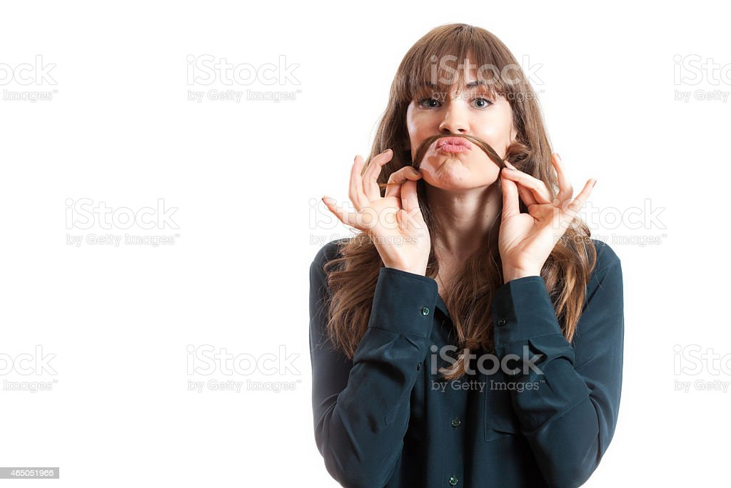 Pretty Female Model Making Fake Mustache With Long Hair stock photo