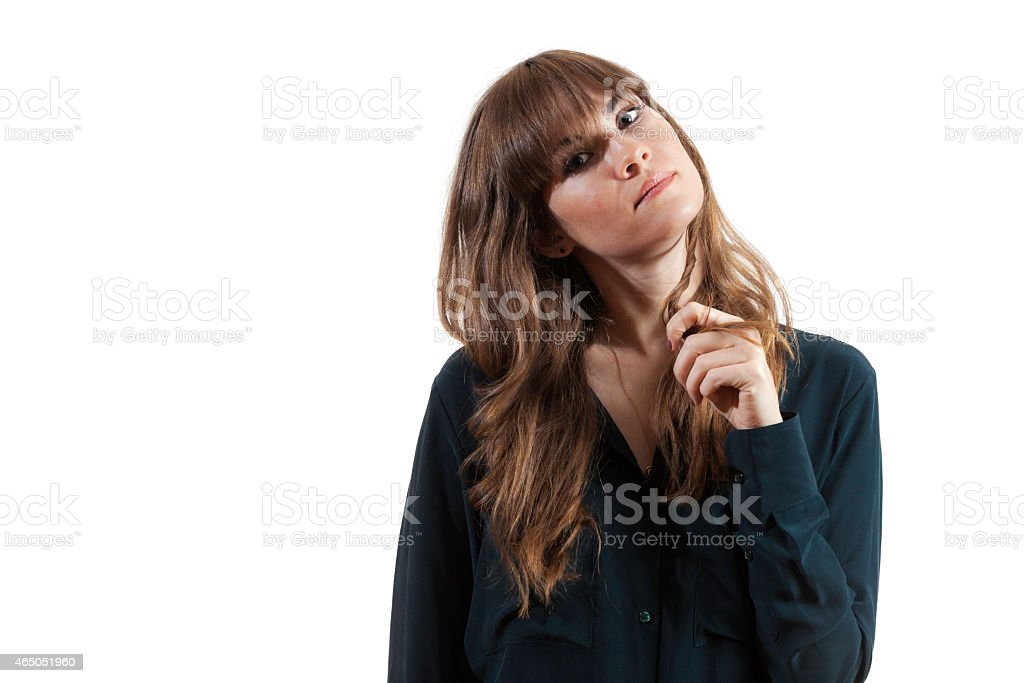 Pretty Female Model Playing with Hair Playfully Isolated White Background stock photo
