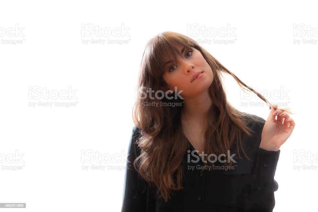 Pretty Female Model Twirling Hair Biting Lip Isolated White Background stock photo