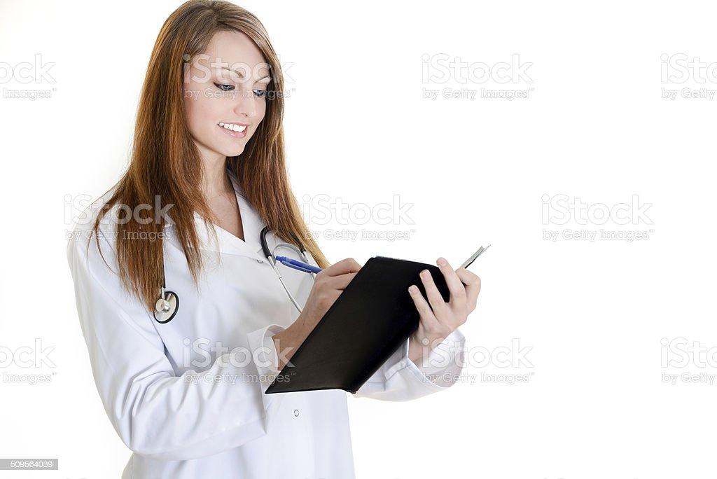 pretty female nurse writing on schedule royalty-free stock photo