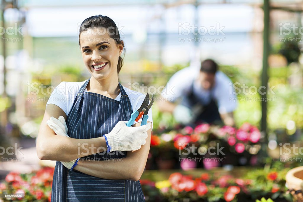 pretty female nursery worker stock photo