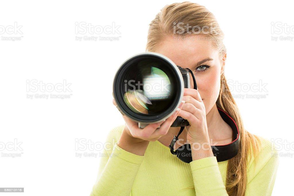 Pretty, female photographer stock photo