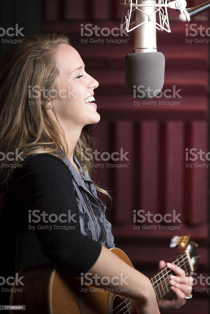 Pretty Female Recording Artist Singer Guitarist royalty-free stock photo