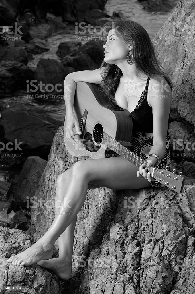 Pretty female singer playing guitar. royalty-free stock photo