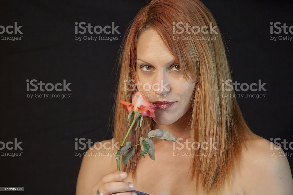 Pretty Female Smelling A Rose royalty-free stock photo