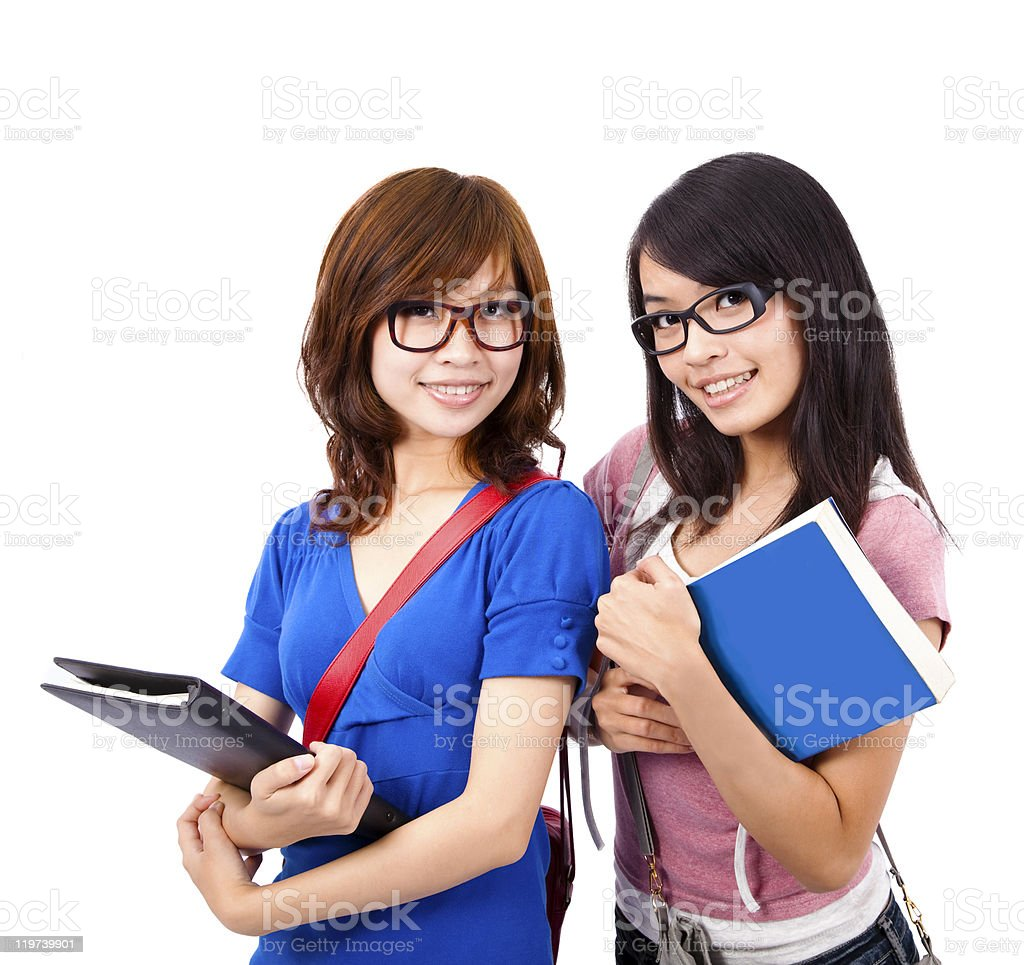 Pretty female students wearing glasses and smiling royalty-free stock photo