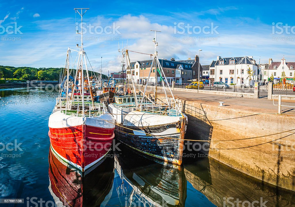 Pretty fishing village harbour trawlers Stornaway Lewis Outer Hebrides Scotland stock photo