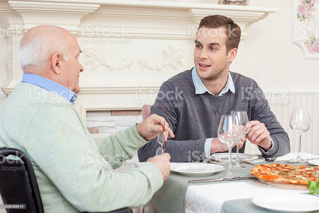 Pretty friendly family has a lunch at home stock photo