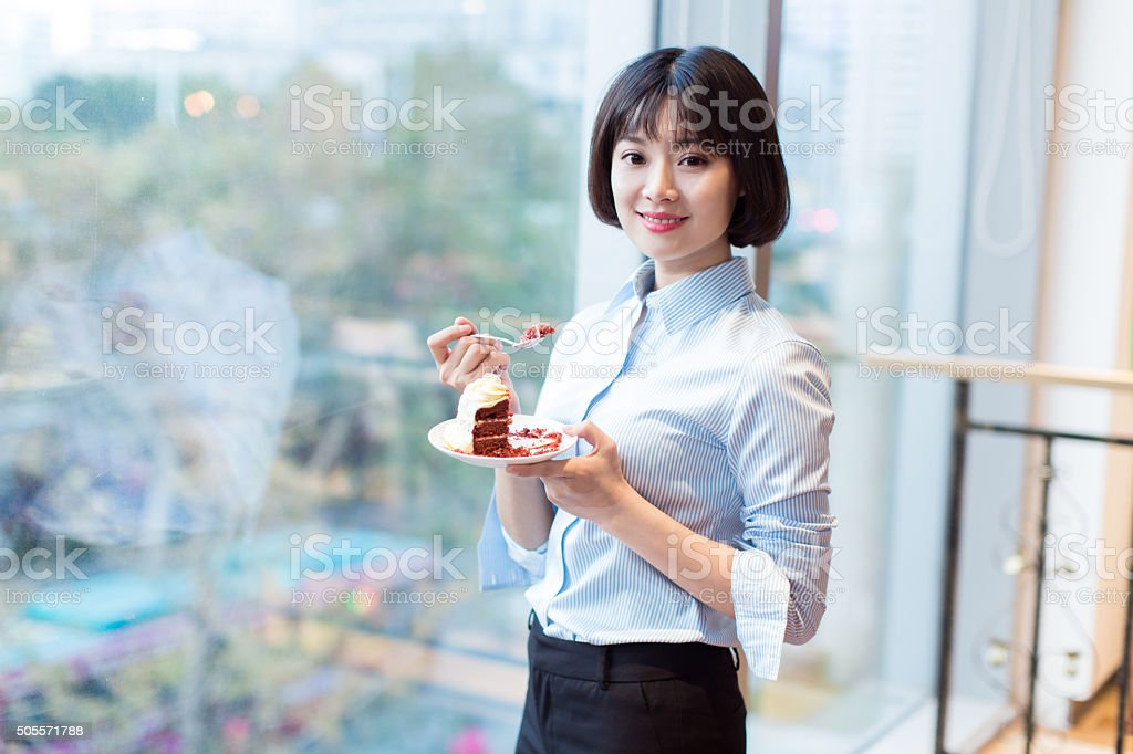 pretty girl and chocolate cake stock photo