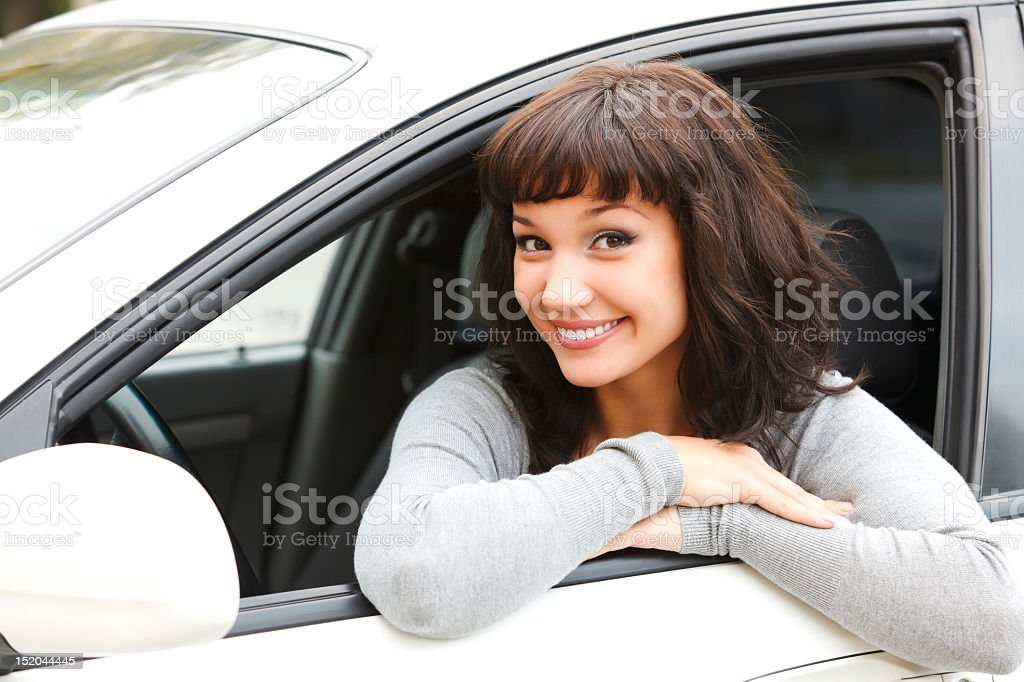 Pretty girl and white car royalty-free stock photo
