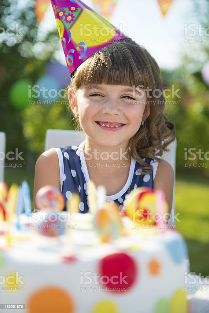Pretty girl at child's birthday party royalty-free stock photo