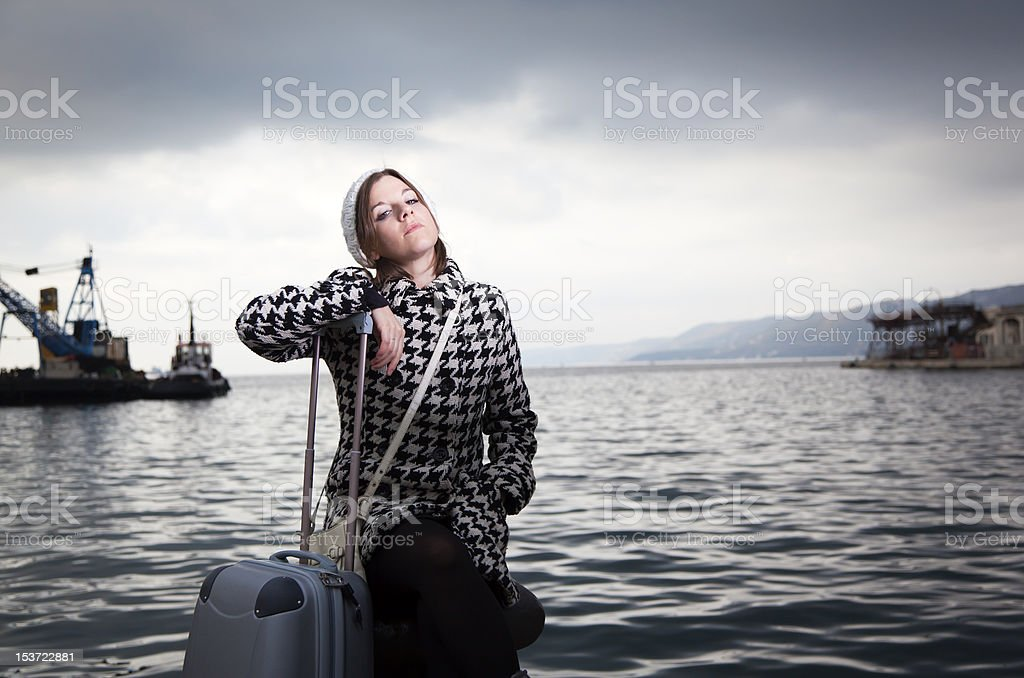 Pretty Girl at the Seaport with Travel Bag royalty-free stock photo