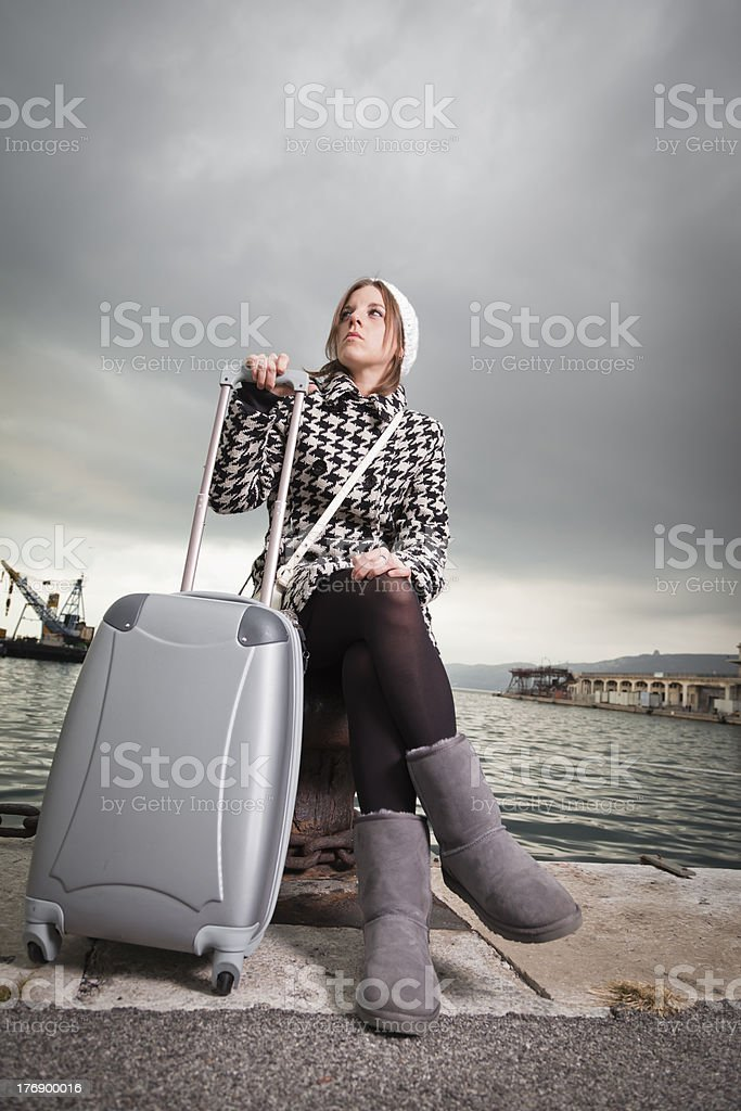 Pretty Girl at the Seaport with Travel Bag stock photo