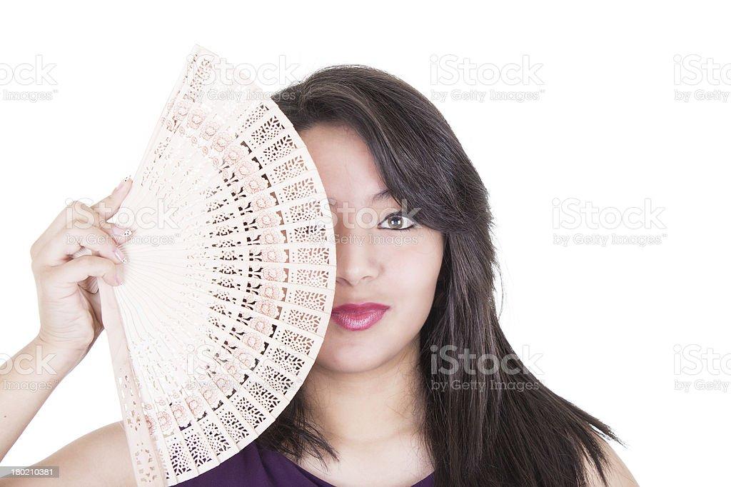 Pretty girl fanning herself stock photo