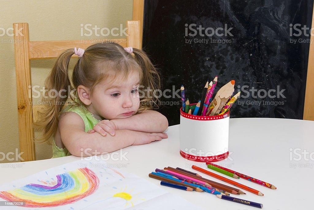 Pretty girl has drawn a rainbow royalty-free stock photo