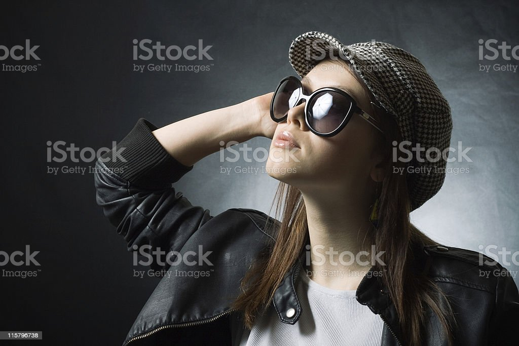 pretty girl in a cap and sunglasses royalty-free stock photo