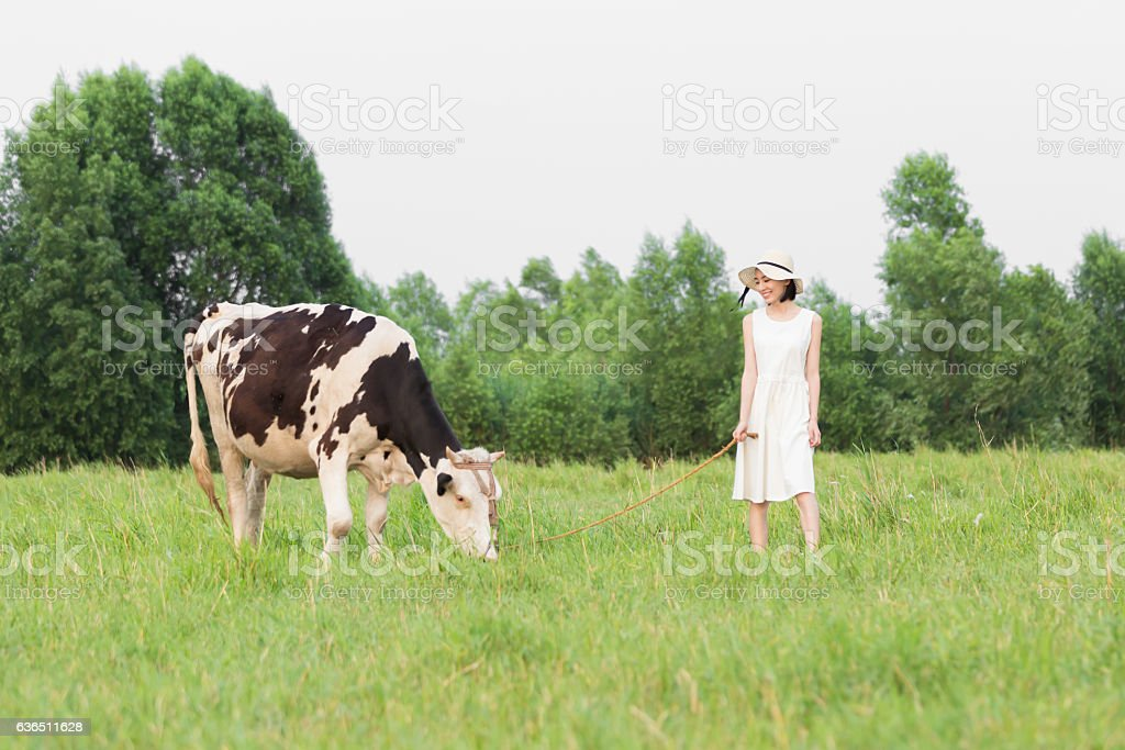 pretty girl in a green pasture stock photo