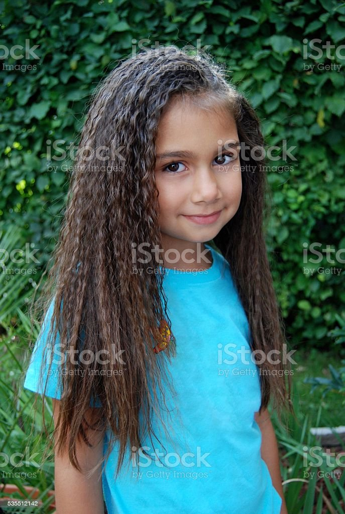 Pretty girl in blue T-Shirt stock photo