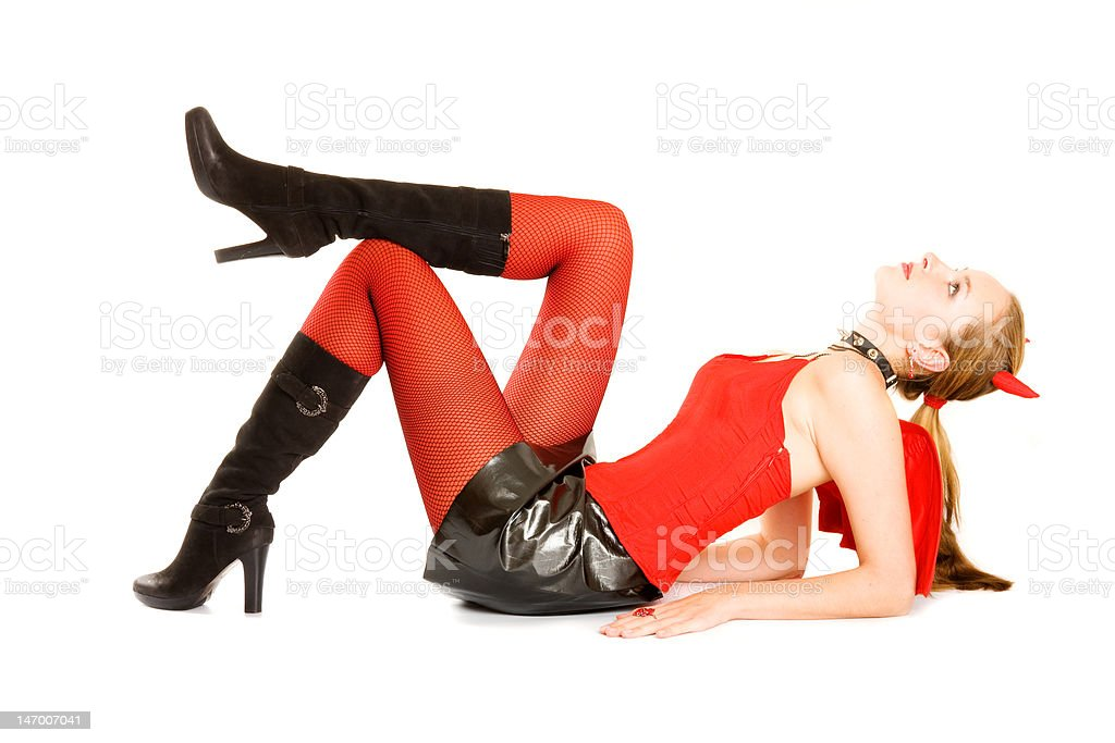 Pretty girl in costume of Halloween young devil royalty-free stock photo