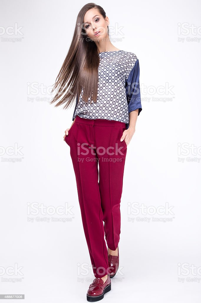 Pretty girl in fashionable stylish clothes, walking on a white stock photo
