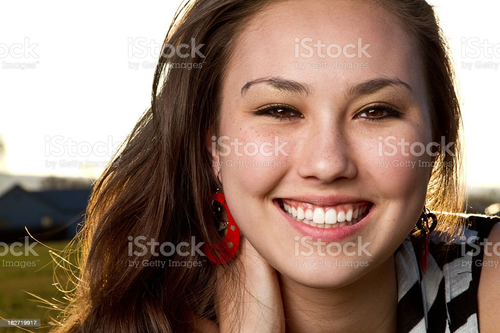 Pretty Girl in Grass at Dusk stock photo
