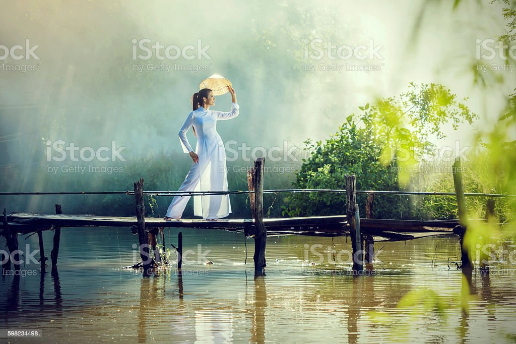 Pretty girl in Vietnam, Ao dai is famous traditional costume stock photo