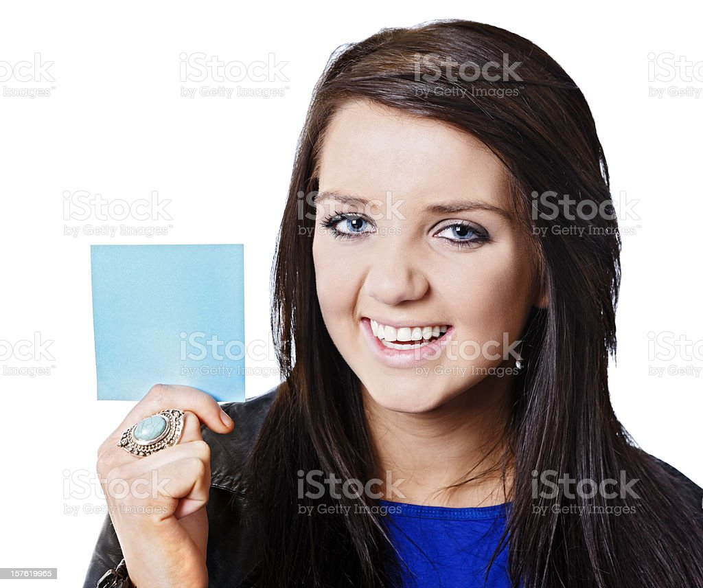 Pretty girl laughs as she holds up blank blue note royalty-free stock photo