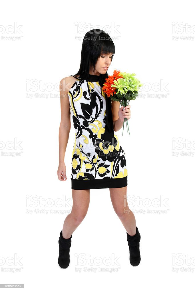 Pretty girl looking at flowers stock photo