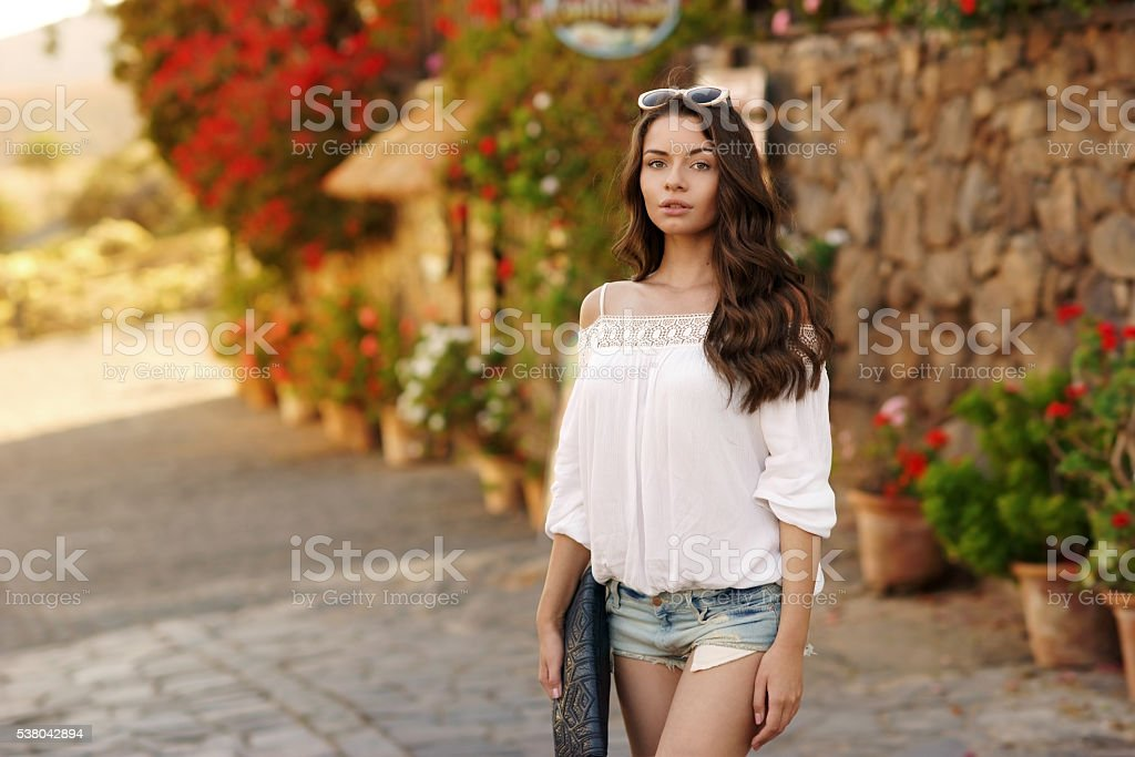 Pretty girl looking at you stock photo