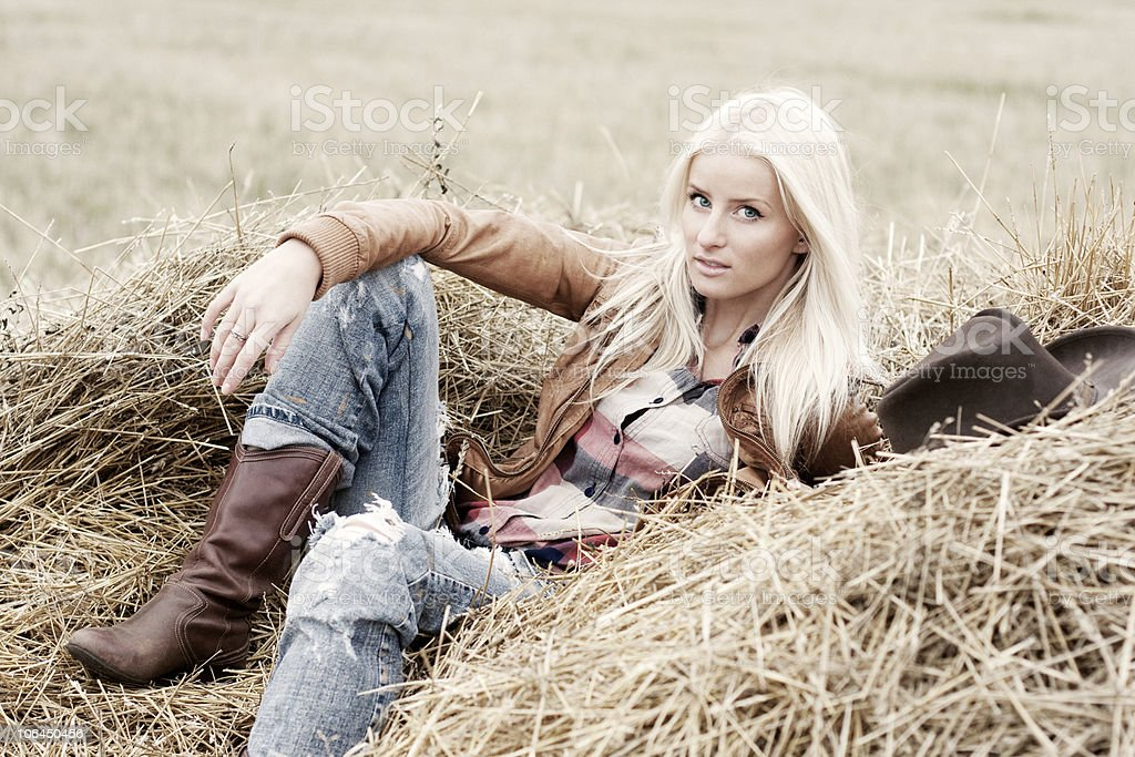 Pretty girl lying on a hay royalty-free stock photo