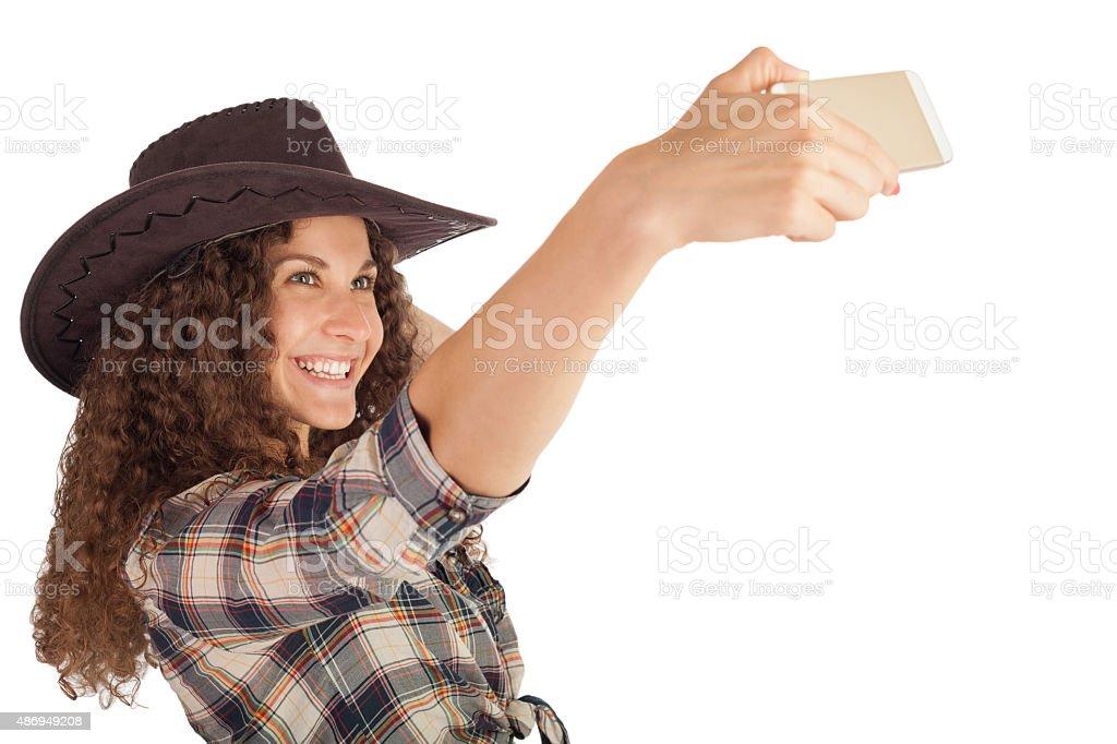 Pretty girl make a self portrait with her smartphone. stock photo