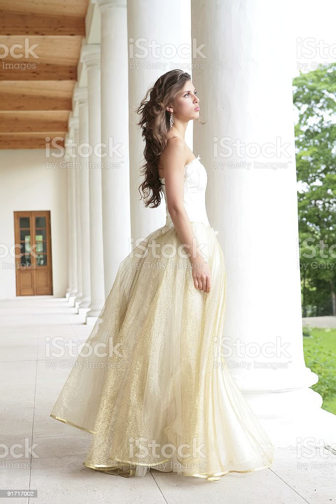pretty girl near pillars stock photo