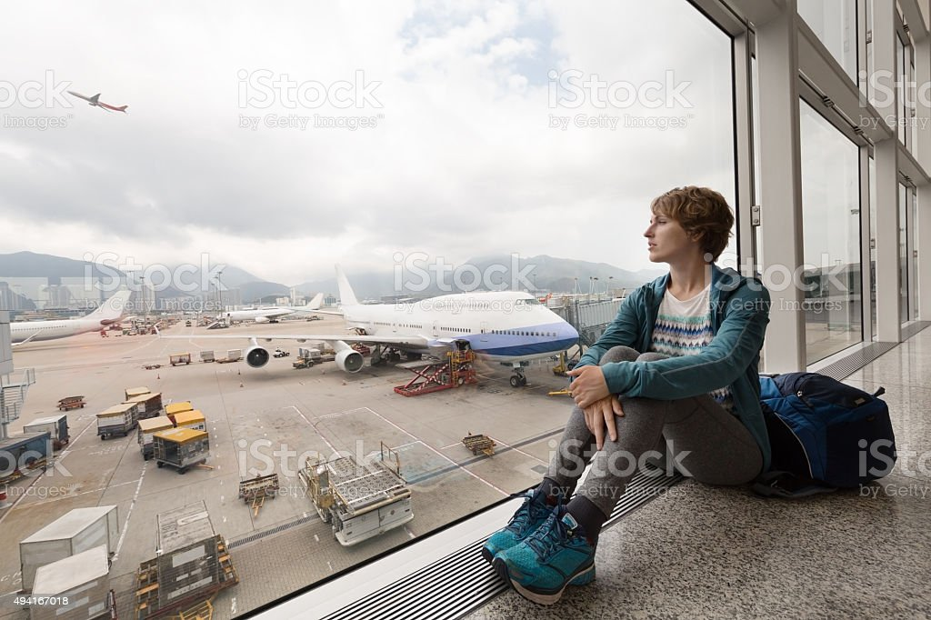 Pretty girl near the window in the airport stock photo