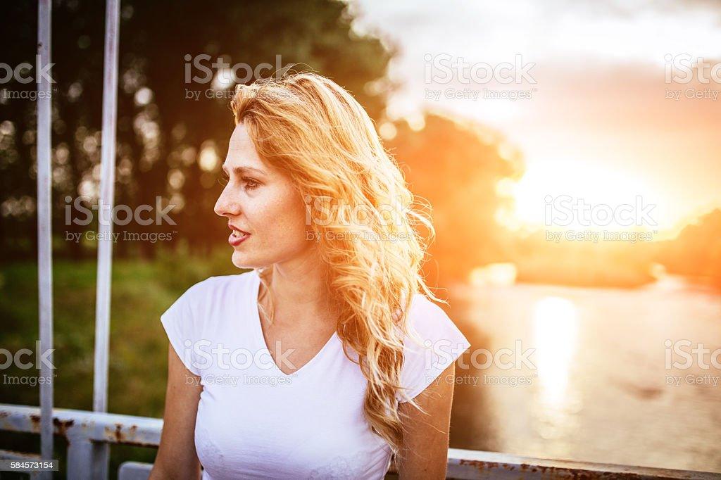 Pretty girl on a bridge stock photo