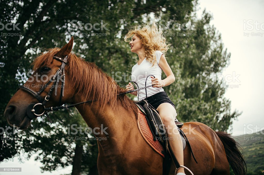Pretty girl on a horse stock photo