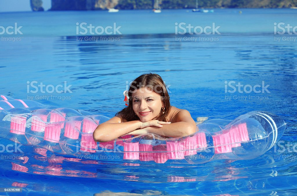Pretty girl on air mattress. royalty-free stock photo
