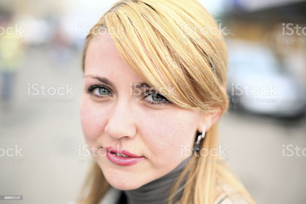 Pretty girl on street. Face close-up stock photo