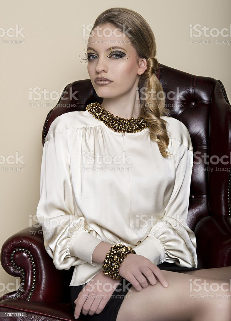 Pretty girl on the chair stock photo