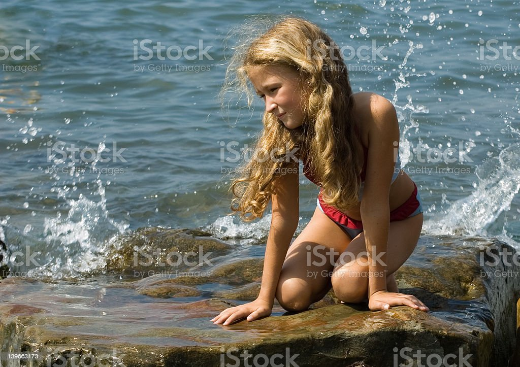 Pretty girl on the rock royalty-free stock photo