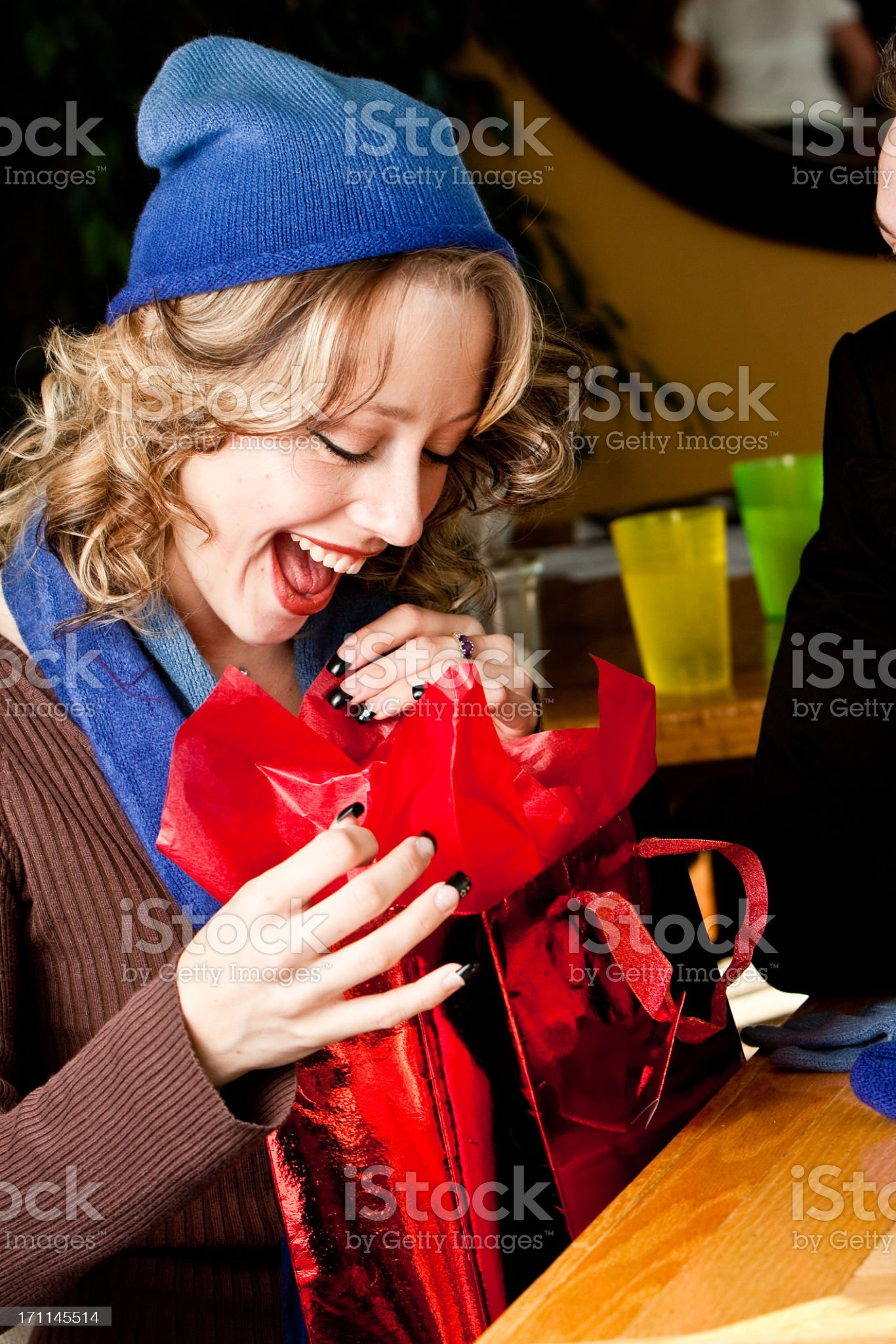 Pretty Girl Opening Gift royalty-free stock photo