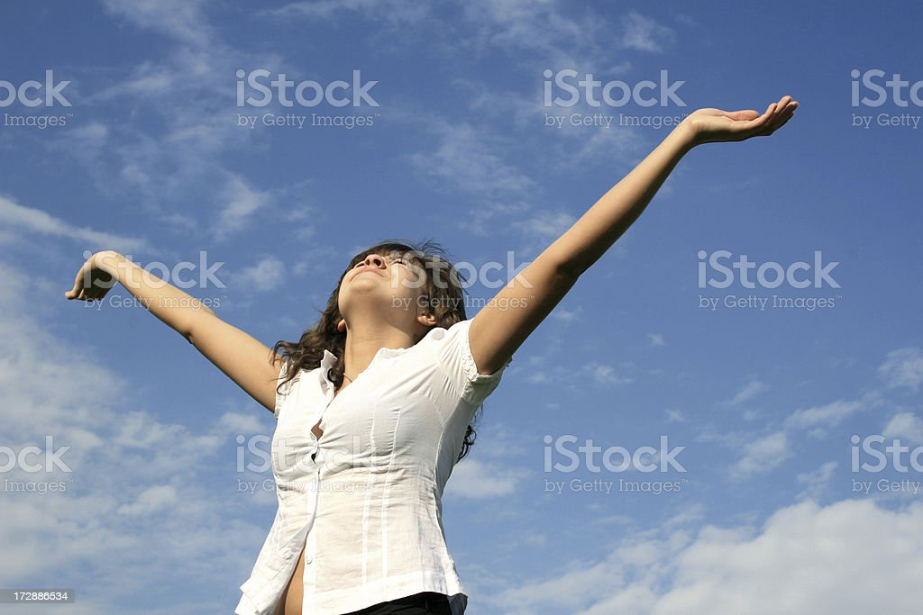 Pretty girl over blue sky looking at the sun royalty-free stock photo
