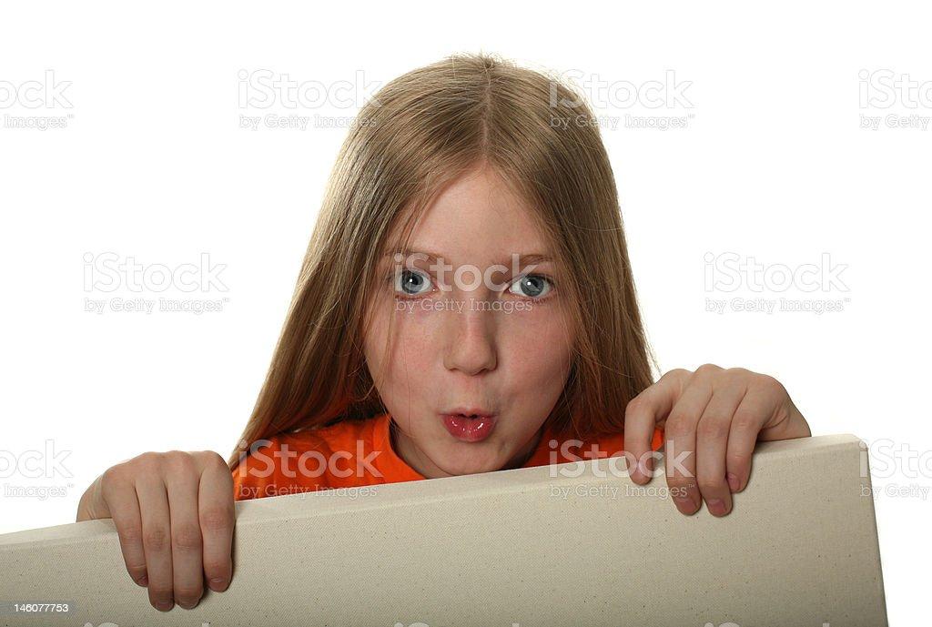 Pretty Girl Peeping Over a Blank Billboard royalty-free stock photo
