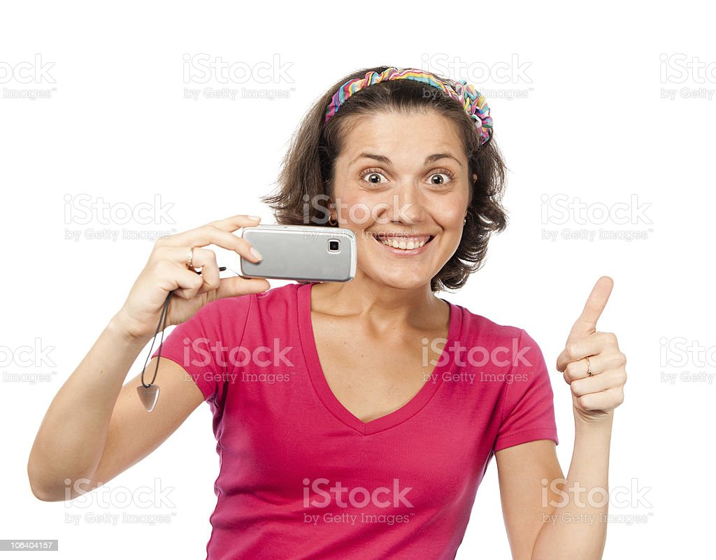 Pretty girl photographed on a mobile phone royalty-free stock photo