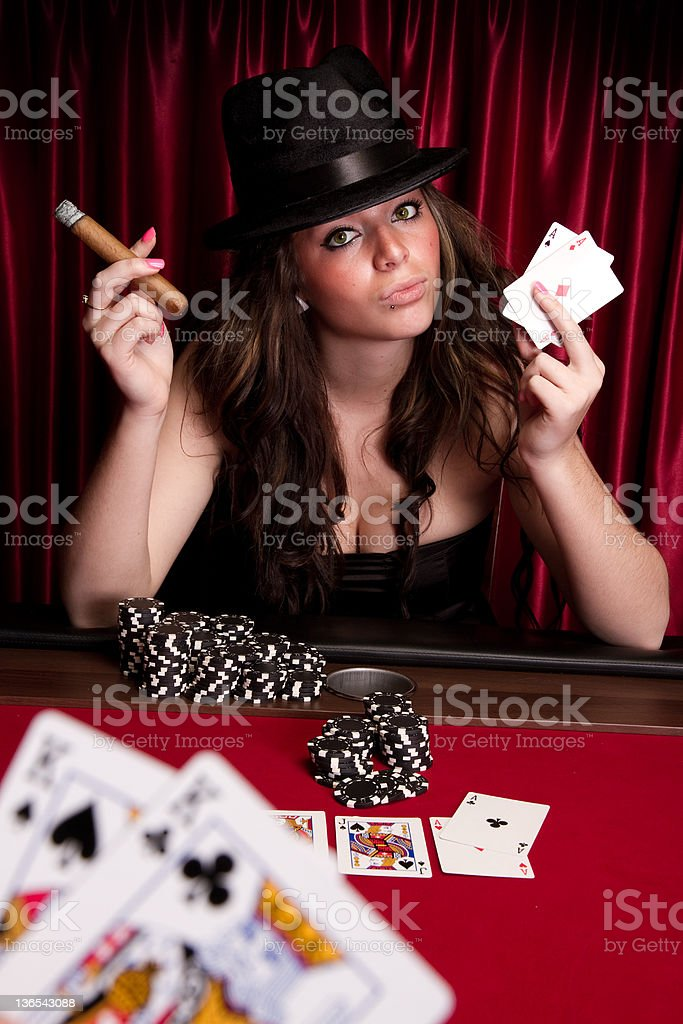 pretty girl playin cards stock photo