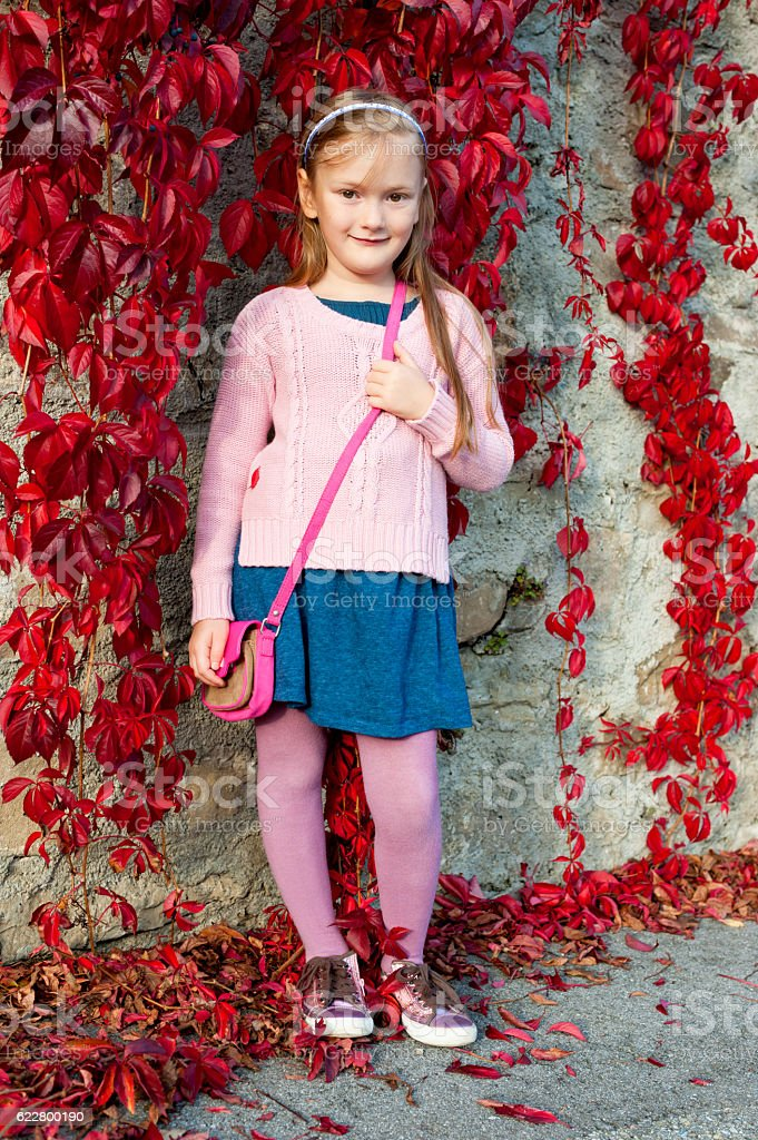 Pretty girl posing outdoors stock photo