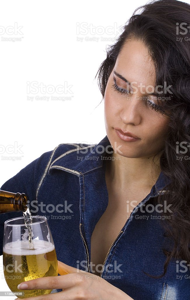 Pretty girl pouring beer. stock photo