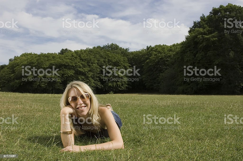 Pretty girl relaxing in the Park stock photo