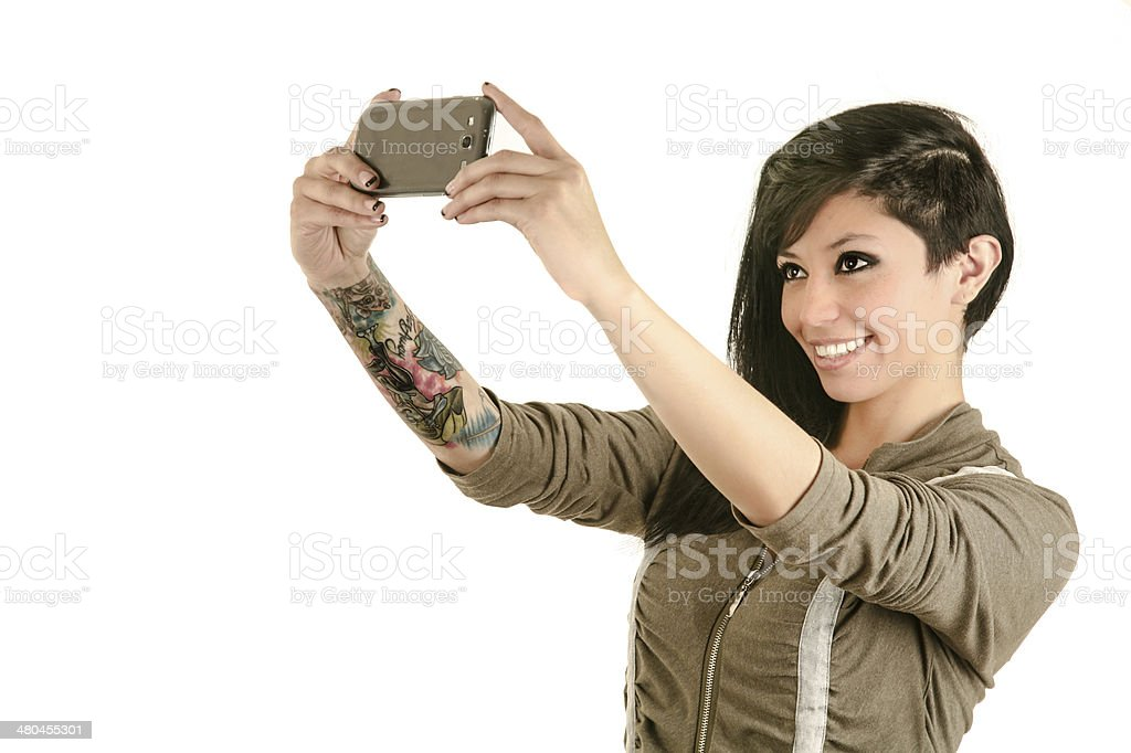 pretty girl take a self portrait with her smart phone stock photo