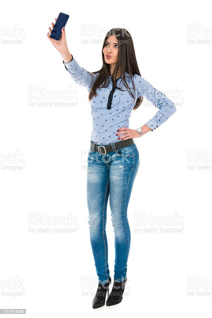 Pretty Girl Take Duck Face Selfie With her Smart Phone stock photo