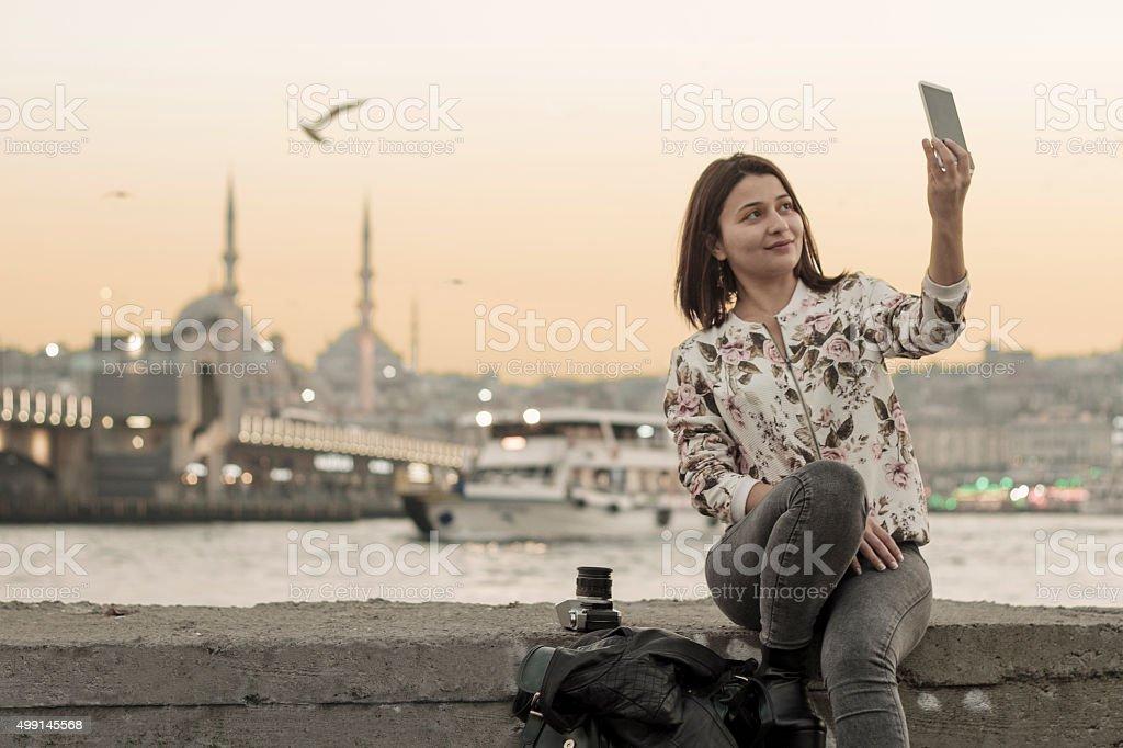 Pretty girl taking a selfie in Istanbul,Turkey stock photo